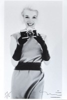 Bert STERN | Marilyn with Nikon | Pigment print available for sale on www.kunzt.gallery
